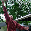 Record-Eagle/Douglas Tesner<br /> Nandy Lukusa, a fifth-grade student at Central Grade School, practices his basketball skills in his grandparents' driveway on Ninth Street.
