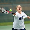 Record-Eagle/Jan-Michael Stump<br /> Traverse City St. Francis' Abby Shrift returns a shot in No. 1 doubles during Friday's Division 4 tennis regional. Rain halted play.