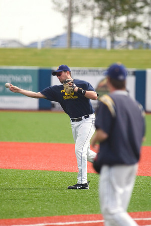 Record-Eagle/Jan-Michael Stump<br /> Beach Bums first baseman C.J. Zeigler throws throw during practice this week.