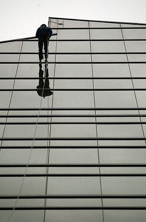 "Record-Eagle/Jan-Michael Stump<br /> Tom Ulatowski, of Traverse City, rappels down the side of the Grand Traverse Resort during Saturday's ""Over the Edge"" fundraiser."