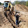 Record-Eagle/Bill O'Brien<br /> Workers learn how to run heavy equipment at a training course in Traverse City.