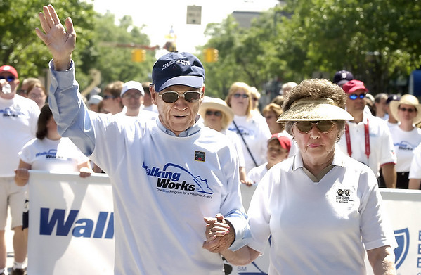 Ernie Harwell marches in the National Cherry Festival's Cherry Royale Parade in 2004.