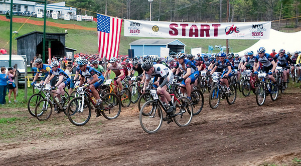 "Record-Eagle/Douglas Tesner<br /> Riders take off from Mt. Holiday in Saturday's Mud, Sweat & Beers mountain bike race. The race, a fundraiser for Mt. Holiday, was capped at 500 riders for the inaugural event. ""It was a huge success,"" race co-director Jim Kalajian said. ""We're absolutely delighted -- astounded, really."""