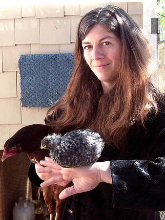 Record-Eagle/Douglas Tesner<br /> Angela Stricker, with one of this spring's chicks, lives with her backyard flock on 12Th Street.