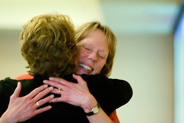 Record-Eagle/Jan-Michael Stump<br /> Sue Peters, vice president of human resources at Munson Medical Center, gets a hug from Denise Busley after being named this year's Athena Award winner during the 16th annual Athena Award Dinner at the Hagerty Center.