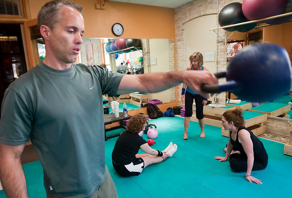 Record-Eagle/Douglas Tesner<br /> Erik Petersen warms up before he leades a kettlebell class at Rock Bottom Gym in Traverse City.