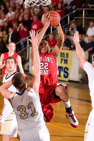 Record-Eagle/Jan-Michael Stump<br /> Dwuan Anderson (22) goes up for two against Traverse City St. Francis.
