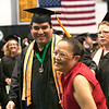 Record-Eagle/Douglas Tesner<br /> Cheryl Kukla congratulates her son, John Kukla, with a hug and smile at Northwestern Michigan College's commencement ceremony.