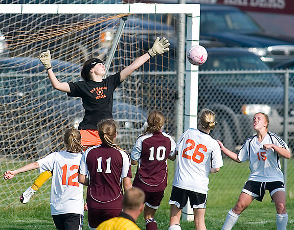 Record-Eagle/Jan-Michael Stump<br /> Elk Rapids goalkeeper Maggie Marshall (right)makes a save during Monday's Lake Michigan Conference soccer game with Charlevoix.