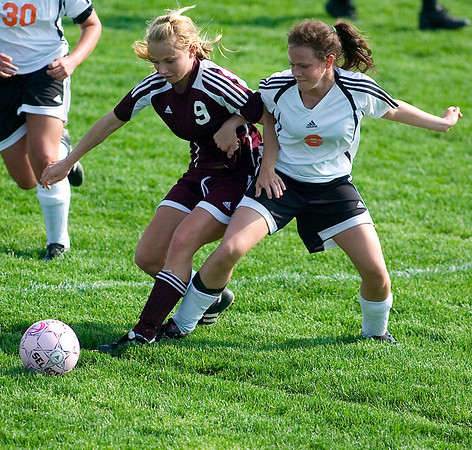 Record-Eagle/Jan-Michael Stump<br /> Charlevoix's Caroline Dupuis (9) and Elk Rapids' Robin Trierweiler (6) battle for possession of the ball. Elk Rapids rallied from a 2-0 deficit to win in overtime.