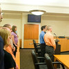 Record-Eagle/Jan-Michael Stump<br /> Supporters stand in court behind former Grand Traverse Sheriff's Deputies Mark Noffke, left, and Robert Sillers as they are sentenced to fines and costs in 86th District Court on Tuesday after pleading guilty to a 90-day misdemeanor charge of neglecting to perform the duties of a public officer.