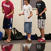 Record-Eagle/Jan-Michael Stump<br /> From left, Octavion Waugh, Nico Ragel-Wilson and Austin Sanders rehearse with other members of the Traverse City West Middle School Madrigals on Thursday.