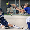 Record-Eagle/ Keith King<br /> Traverse City St. Francis' Ellen Kendziorski slides to beat the throw to Kalkaska's Brittney Short at third base Wednesday in Traverse City.