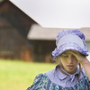 Record-Eagle/Jan-Michael Stump<br /> Paige Granger, 13, an eighth-grader from Cherryland Middle School, tries to stay cool in the shade Samels Farm in Williamsburg on Wednesday. Cherryland eighth-graders dressed in period clothing to teach Mill Creek Elementary School fourth-graders about life on a turn-of-the-century farm. During the course of the school year, students researched over specific areas of farm life -- such as the blacksmith shop, garden and house -- then wrote scripts for their presentations with mentoring from docents at the Samels Farm Heritage Society.