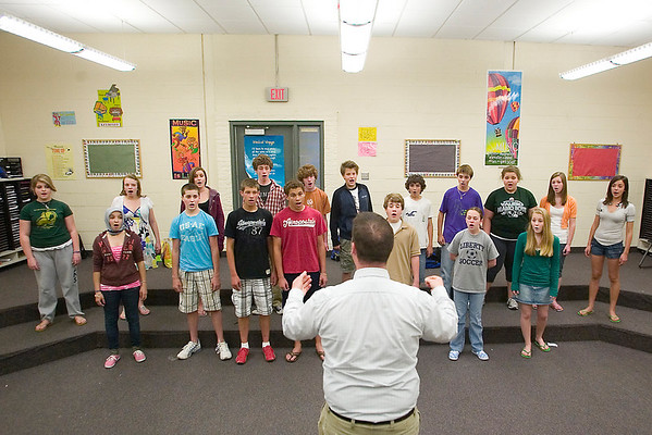 "Record-Eagle/Jan-Michael Stump<br /> Phil Johnson leads the the Traverse City West Middle School Madrigals vocal group through a rehearsal Thursday. The group is one of 10 finalists in a national mash-up contest -- where groups mix two songs together in their performance. The performance, a mash-up of the Jackson 5's ""I Want You Back,"" and The Fray's ""Over My Head (Cable Car),"" can be voted for online, with the winning school to receive $10,000."