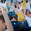 Record-Eagle/ Keith King<br /> Fans cheer as part of a contest Friday prior to the start of the Traverse City Beach Bums 2010 home-opening game against the Oakland County Cruisers at Weurfel Park.