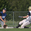Record-Eagle/ Keith King<br /> Kalkaska's Brandon Washburn catches the ball to tag out Traverse City St. Francis' Jake Peacock at second base Wednesday during a doubleheader at St. Elizabeth Ann Seton Middle School in Traverse City.