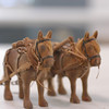 Record-Eagle/Lisa Perkins<br /> A pair of three inch horses carved by folk artist William Drain are among the miniatures that will be on display at the Grand Traverse Heritage Center.