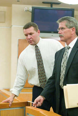 Record-Eagle/Jan-Michael Stump<br /> Traverse City police officer Joseph Soffredine, left, pleads guilty to impaired driving Tuesday in 86th District Court. At right is his attorney, Clarence Gomery.