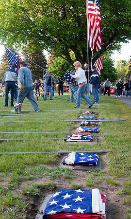 Record-Eagle/Douglas Tesner<br /> Volunteers and Veterans of Foreign Wars members raised more than 648 American flags at Grand Traverse Memorial Gardens Cemetery in Traverse City for the Memorial Day holiday.