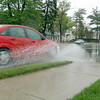 Record-Eagle/Sarah Brower<br /> Large puddles accumulate on roads in Traverse City.