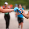 Record-Eagle/Sarah Brower<br /> Traverse City State Bank held its 27th annual Bayshore Marathon. The runners reached the halfway point and were glad to have volunteers handing out water.