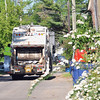 Record-Eagle/Vanessa McCray<br /> An American Waste truck moves through the Traverse City alley north of Sixth Street. The hauler's city contract includes the pick up of one bulky item per month for some residents, a factor that led the city to discontinue its own spring clean up service that once removed furniture and other junk from alleys.