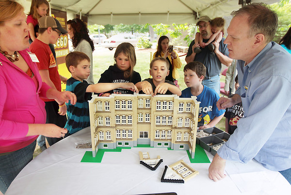 Record-Eagle/Keith King<br /> Dan Parker, one of 13 Lego certified professionals in the world, provides tips and instruction with creating an artistic representation of the Grand Traverse Commons' Building 50 on Saturday.