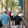Record-Eagle/Keith King<br /> Pedestrians travel on a sidewalk Friday in downtown Traverse City.