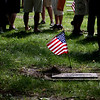 Record-Eagle/Jan-Michael Stump<br /> A crowd lingers following Monday's Grand Traverse Area Memorial Day Ceremony at Oakwood Cemetery, near the gravesite of World War I veteran Lloyd H. Walling.