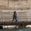 Record-Eagle/Douglas Tesner<br /> A fisherman relaxes in the warm evening sun as he waits for a bite on the hydroelectric dam in Elk Rapids.
