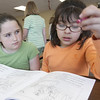 Record-Eagle/Douglas Tesner<br /> Fifth-grade student Kearsten Frusti, 10, works with her second-grade partner Serena Mendoza, 7, during a Cinco de Mayo party at Old Mission Peninsula School. Both students take part in Spanish class at the school.