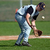Record-Eagle/Jan-Michael Stump<br /> TC Central pitcher Jason Winowiecki (21) fields a bunt Tuesday.