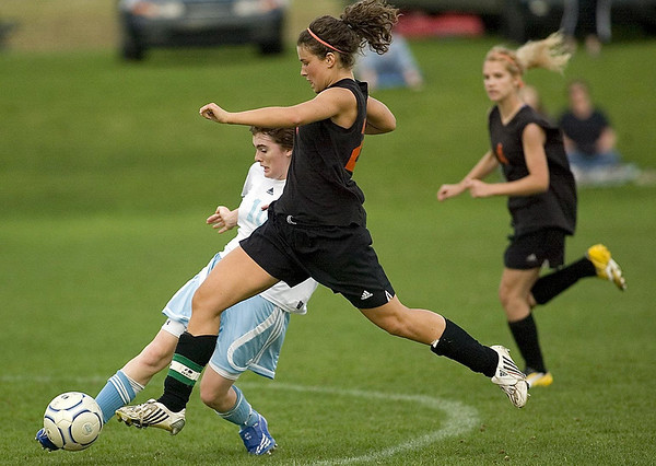 Record-Eagle/Jan-Michael Stump<br /> Elk Rapids' Olivia Morrison (29) tries to take the ball from Traverse City Liberty's Mary Raetz (10) in the second half of Thursday's game.