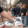 "Record-Eagle/Douglas Tesner<br /> David Mainz hands out stickers and bumper stickers to movie fans standing in line for free tickets to a surprise showing of the new ""Star Trek"" movie Wednesday evening at the State Theatre. In addition to tickets, popcorn and sodas also were free. Tickets were gone in 12 minutes, according to Mike Assenmacher, a box office volunteer."