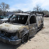 Record-Eagle/Art Bukowski<br /> A burned Steam Pro van sits in the Ward Eaton Towing lot in Garfield Township Tuesday afternoon.