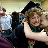 Record-Eagle/Jan-Michael Stump<br /> Sharon Pierce gets a hug from her daughter Kirstin Pierce while her husband Michael Pierce looks on following Northwestern Michigan College's 2009 commencement ceremony Saturday at Traverse City Central High School.