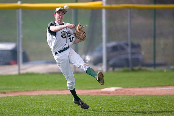 Record-Eagle/Jan-Michael Stump<br /> Traverse City West third baseman Grant Durga (10) makes the throw to first for an out against TC Central.