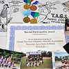 Record-Eagle/Vanessa McCray<br /> Certificates, medals, posters and team photos are some of the mementos Betty McGrew saved from her years as a coach and board member for Traverse Area Girls Softball. The organization celebrates its 20th anniversary this year.