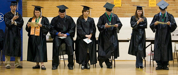 Record-Eagle/Jan-Michael Stump<br /> Northwestern Michigan College students wait for the start of Saturday's 2009 commencement ceremony at Traverse City Central High School. More than 170 students graduated with degrees and certificates.