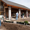 "Record-Eagle/Douglas Tesner<br /> Construction continues on a half-million-dollar renovation at Apache Trout Grill along M-22 just north of Traverse City. The project will enclose the restaurant's popular patio with collapsible glass doors to provide year-round seating. ""It's still going to be a patio in the summer and 50 seats are added year-round,"" owner Mike Connors said. The project was designed by DesRosiers Architects and CMI Construction is the contractor. The addition is scheduled to open for the Memorial Day weekend."