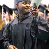 Record-Eagle/Jan-Michael Stump<br /> Kenneth Williams waves to family during the Northwestern Michigan College's 2009 commencement ceremony's processional.