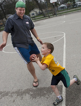 Record-Eagle/Douglas Tesner<br /> Shea Harmeson, 4, plays a little basketball with his friend Matt Scherbing at the Grand Traverse Civic Center Thursday. Shea is the son of Scherbing's girlfriend and, according to Scherbing, is his best friend.