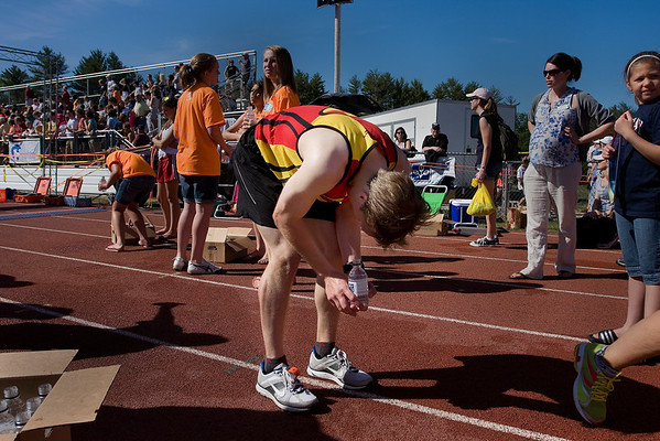 Record-Eagle/ Keith King<br /> Brandon Wise, of Kalamazoo, stops to relax on the track at Traverse City Central High School Saturday after finishing the marathon.