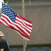 Record-Eagle/Jan-Michael Stump<br /> Don Storing, of Gaylord, carries the American flag at the Open Space in Traverse City, where he and other Veterans for Peace members placed 185 crosses for each Michigan soldier killed in the Iraq and Afghanistan wars as part of Monday's Memorial Day observances.
