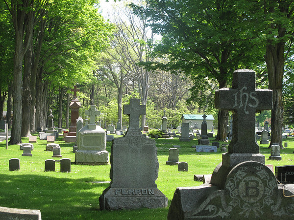 Record-Eagle/Vanessa McCray<br /> Traditional cross-adorned markers fill up the Catholic portion of the Oakwood Cemetery in Traverse City.