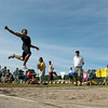 Record-Eagle/Jan-Michael Stump<br /> Traverse City Central's Pho Phenkhamkip won the long jump with this leap of 21 feet in the Record-Eagle Honor Roll track meet Tuesday at Traverse City Central.