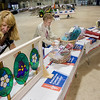 Record-Eagle/ Keith King<br /> Penny Gersewski, left, and Linda Walmsley, both of Alpena, help set up a silent auction Friday for the American Cancer Society Relay for Life at the Grand Traverse County Civic Center. The event begins today.