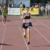 Record-Eagle/ Keith King<br /> Liz Shelton, of Texas, races to the finish line to capture the women's 10K Saturday.