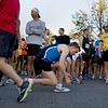 Record-Eagle/ Keith King<br /> Chad Connor, of Dayton, Ohio, middle, ties his shoes Saturday as he prepares for the start of the Traverse City State Bank Bayshore Marathon.